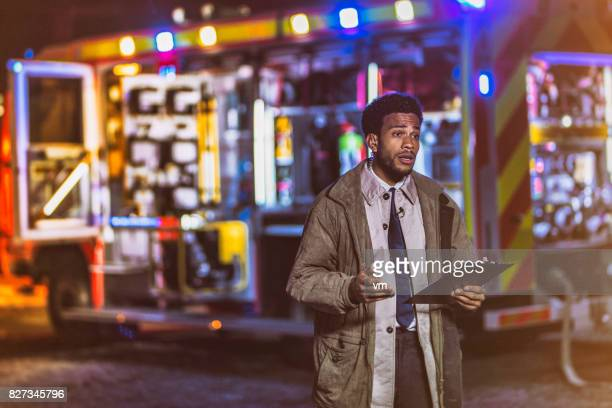 tv reporter about night arson - journalist stock pictures, royalty-free photos & images