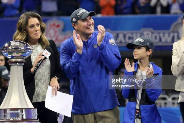 ESPN reporter Allison Williams and Florida Gators head coach Dan Mullen after the Peach Bowl between the Florida Gators and the Michigan Wolverines...