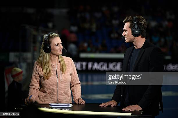 Reporter and host Stine Bjerre Jorgensen of TV2 Sporten Denmark and handball expert Claus Moller Jakobsen reports to live television prior to the...
