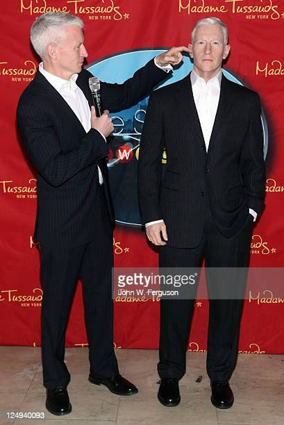 Reporter and TV host Anderson Cooper unveils his wax figure at Madame Tussauds on September 14 2011 in New York City