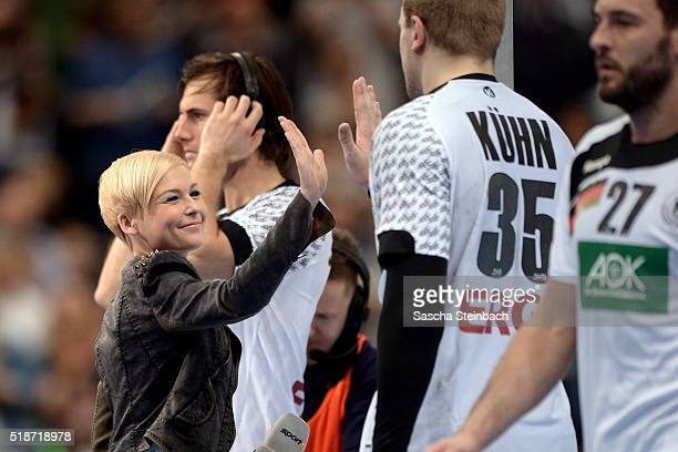 Reporter Anett Sattler reacts after the Handball international friendly match between Germany and Denmark at Lanxess Arena on April 2 2016 in Cologne...