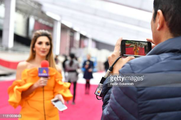Reporter Antonella Michelena Garcia broadcasts from red carpet rollout in preparation for the 91st Annual Academy Awards at Dolby Theatre on February...
