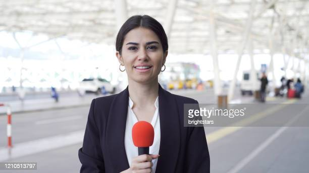 tv reporter at the airport - journalist stock pictures, royalty-free photos & images