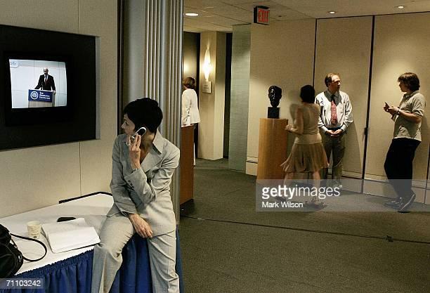 Reporter Catherine Herridge watches US Homeland Security Secretary Michael Chertoff speak on a video monitor in the lobby in the Brookings Institute...