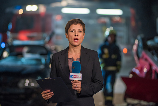 Reporter covering news