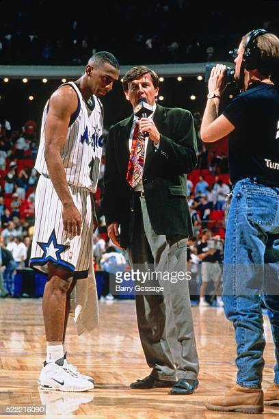 Reporter Craig Sager interviews Anfernee Hardaway of the Orlando Magic during a game circa 1996 at the Orlando Arena in Orlando Florida NOTE TO USER...