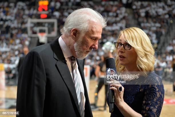 Reporter Doris Burke interviews Gregg Popovich of the San Antonio Spurs after Game Three of the Western Conference Finals against the Golden State...