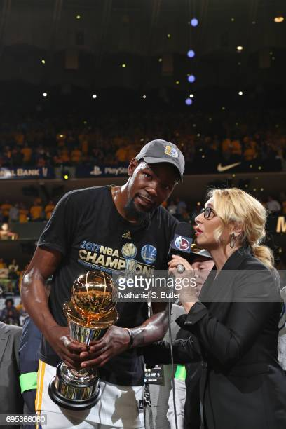 Reporter Doris Burke interviews Kevin Durant of the Golden State Warriors after winning the Finals MVP in Game Five of the 2017 NBA Finals against...