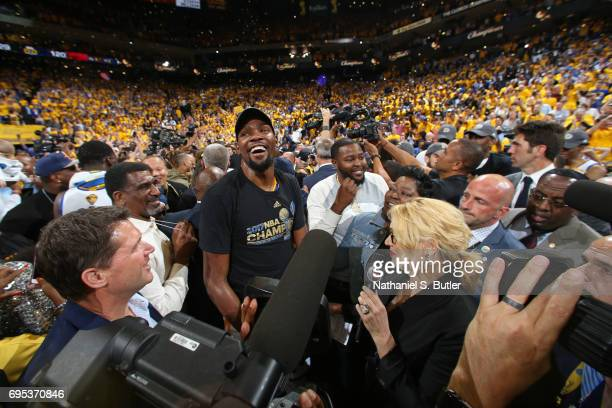 Reporter Doris Burke interviews Wanda Durant and Kevin Durant of the Golden State Warriors after winning Game Five of the 2017 NBA Finals against the...