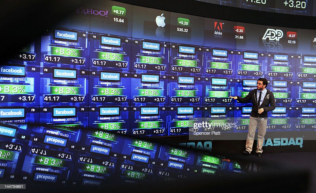A reporter for French TV stands onstage as the share price of newly debuted Facebook stock is viewed at the Nasdaq stock market moments after it went public on May 18, 2012 in New York, United States. The social network site began trading after 11:30 a.m. with shares jumping 13% to $43 before quickly falling. On Thursday Facebook priced 421 million shares at $38 each. Facebook, a Menlo Park, California based company, will have a valuation exceeding $100 billion.