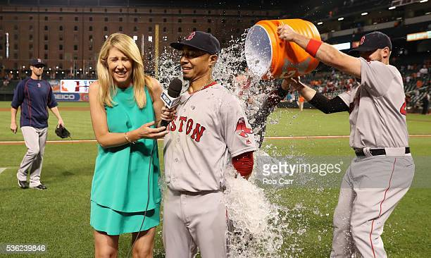 Reporter Guerin Austin and Mookie Betts of the Boston Red Sox are doused with water after the Red Sox defeated the Baltimore Orioles 62 at Oriole...