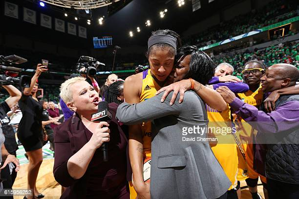 ESPN reporter Holly Rowe interviews Candace Parker of the Los Angeles Sparks hugging General Manager Penny Toler after defeating the Minnesota Lynx...