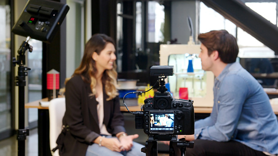 Reporter interviewing in a 3D printing office 920357244