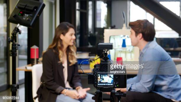 reporter interviewing in a 3d printing office - film set stock pictures, royalty-free photos & images