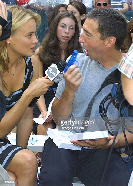 A reporter interviews Ron Reagan the son of former US President Ronald Reagan during the Kenneth Cole Spring 2002 collection show September 10 2001...