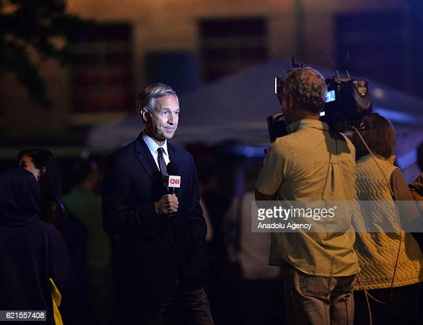 CNN reporter is seen before Jon Bon Jovi's campaign for Hillary Clinton during a public 'Get Out The Early Vote' event at the Filmore in Charlotte...