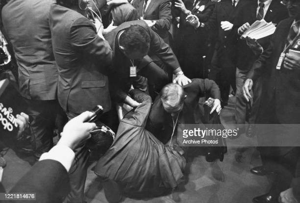 Reporter is thrown to the ground in a scuffle with security staff on the third day of the 1968 Democratic National Convention, held at the...