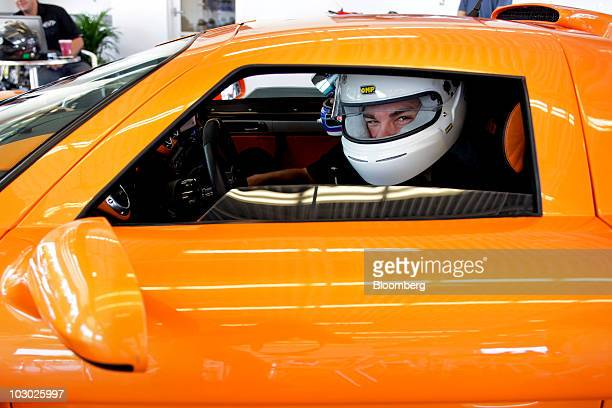 Reporter Jason Harper sits behind the wheel of a Gumpert Apollo supercar before driving on the track at Monticello Motor Club in Monticello, New...