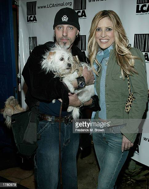 Reporter Jillian Barberie and Chris Ameruoso attend the Last Chance For Animals fundraiser party on February 12 2003 in Los Angeles California The...