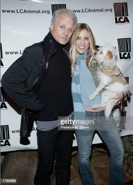 Reporter Jillian Barberie and Michael Des Barres attend the Last Chance For Animals fundraiser party on February 12 2003 in Los Angeles California...