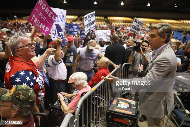 CNN reporter Jim Acosta speaks to people before the arrival of President Donald Trump for his Make America Great Again Rally at the Florida State...