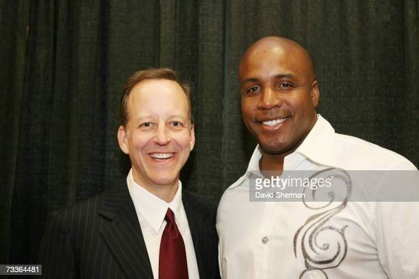 TNT reporter Jim Gray poses with San Francisco Giants outfielder Barry Bonds prior to the 2007 NBA AllStar Game on February 18 2007 at the Thomas...