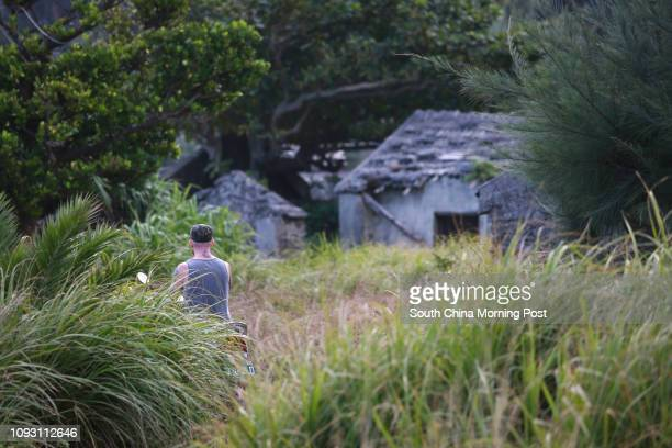 Reporter Joe Henley in Youzihu Aboriginal abandoned village Green Island Taiwan 23OCT17 SCMP / James Wendlinger [2017 FEATURE]#10
