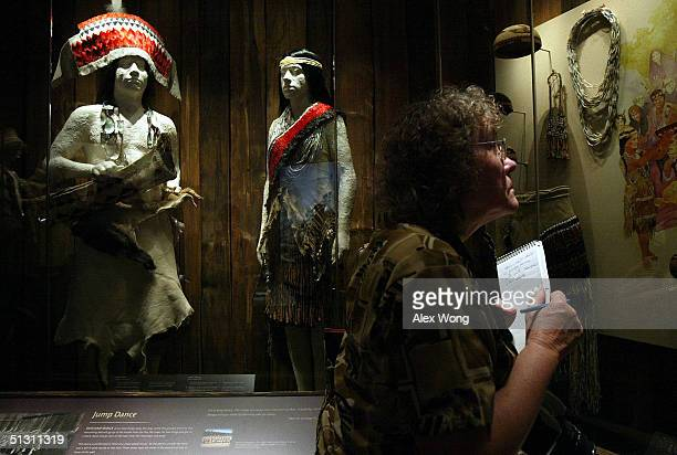 Reporter Karen Toussaint of the Aegis Newspaper in Bel Air Maryland views a display on Indian dance during a press preview September 15 2004 at the...