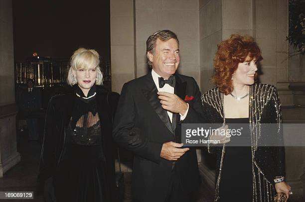 L R Reporter Katie Wagner actor Robert Wagner and actress Jill St John at an evening event circa 2000