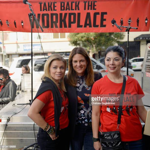 TV reporter Lauren Sivan producer Cathy Schulman and Tess Rafferty pose at the Take Back The Workplace March on November 12 2017 in Hollywood...