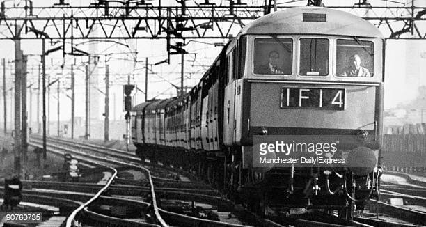 Reporter Les Poole in the cab with driver Joe Hillage on the newly electrified railway system Les Poole�s article reported that the train touching 98...