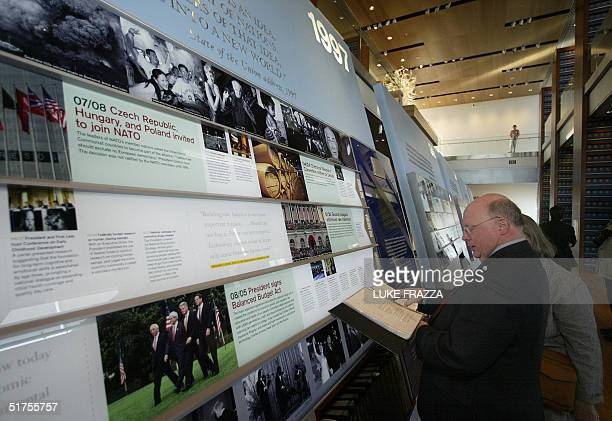 Reporter looks at an exhibit at the soon-to-be opened William J. Clinton Presidential Library in Little Rock, Arkansas 17 November 2004 during a...