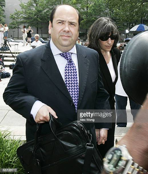 Reporter Matt Cooper of Time magazine and his wife Mandy Grunwald arrive at a US district court with his wife Mandy Grunwald July 6 2005 in...