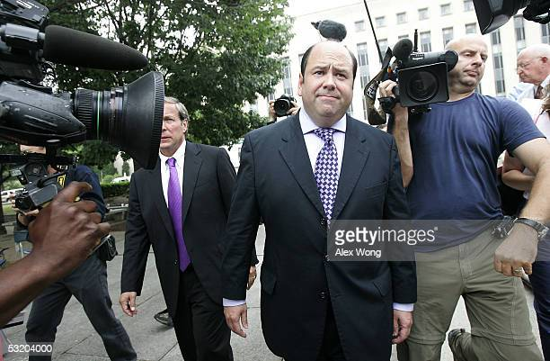 Reporter Matt Cooper of Time magazine leaves a US district court with his lawyer Richard Sauber July 6 2005 in Washington DC Cooper and Judith Miller...