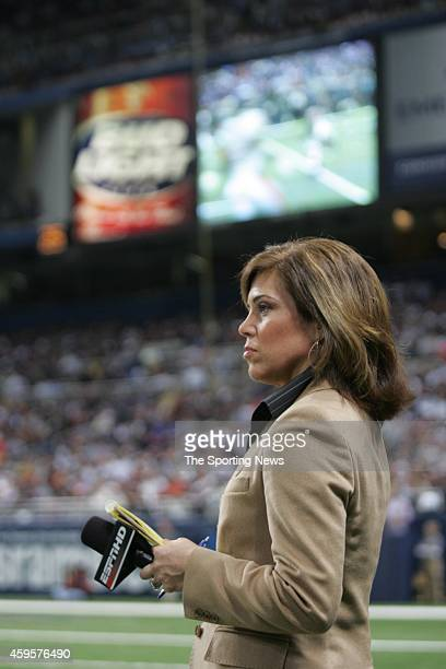 ESPN reporter Michele Tafoya looks on from the sidelines during a game between the Chicago Bears and the St Louis Rams on December 11 2006 at the...