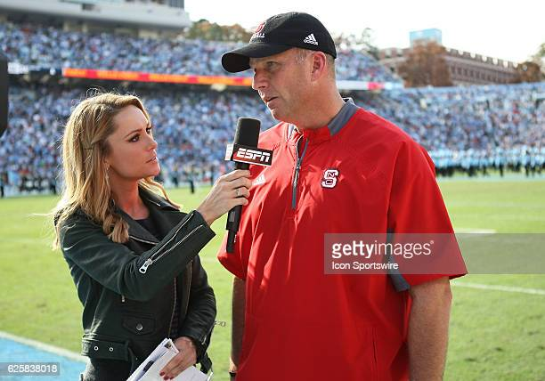 ESPN reporter Molly McGrath asks North Carolina State Wolfpack head coach Dave Doeren a few questions during half time of the NCAA football game...