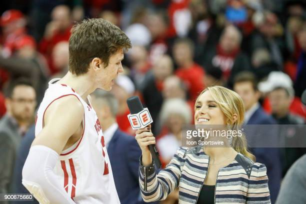 ESPN reporter Molly McGrath interviews Wisconsin forward Ethan Happ following a college basketball game between the University of Wisconsin Badgers...