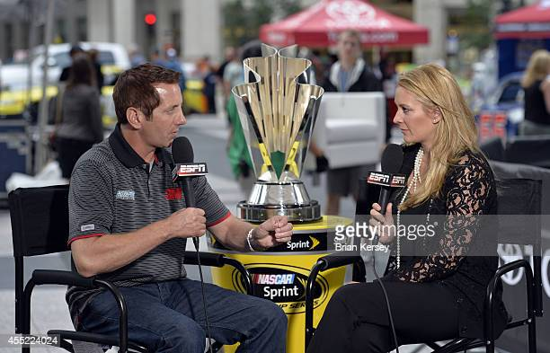 Reporter Nicole Briscoe interviews Greg Biffle driver of the 3M Call Before You Dig Ford at a NASCAR Chase Across North America event on September 10...