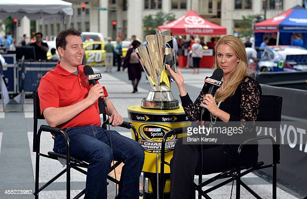ESPN reporter Nicole Briscoe interviews Kyle Busch driver of the MM's Toyota at a NASCAR Chase Across North America event on September 10 2014 in...