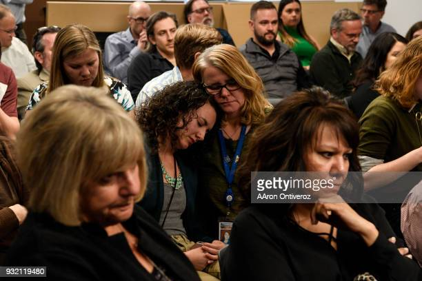 Reporter Noelle Phillips consoles reporter Elizabeth Hernandez during an announcement of forthcoming layoffs to the Denver Post newsroom on Wednesday...