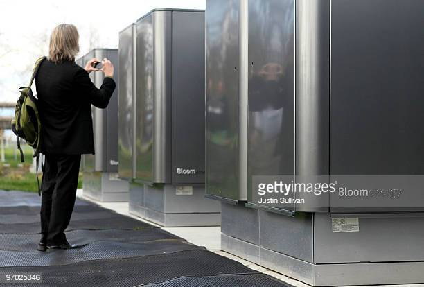 A reporter photographs an installation of new Bloom Energy servers called the 'Bloom Box' at the eBay headquarters February 24 2010 in San Jose...