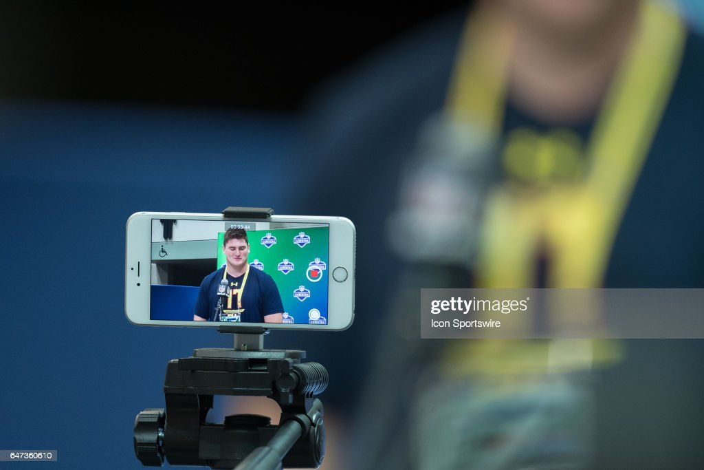 A reporter records the media session of Indiana offensive lineman Dan Feeney during the NFL Scouting Combine on March 2, 2017 at Lucas Oil Stadium in Indianapolis, IN.
