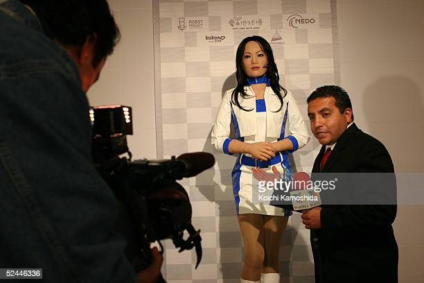 TV reporter reports on a communication robot 'Actroid' during the press day of the Aichi Expo 2005 March 18 2005 in Nagakute Japan Aichi Expo 2005...