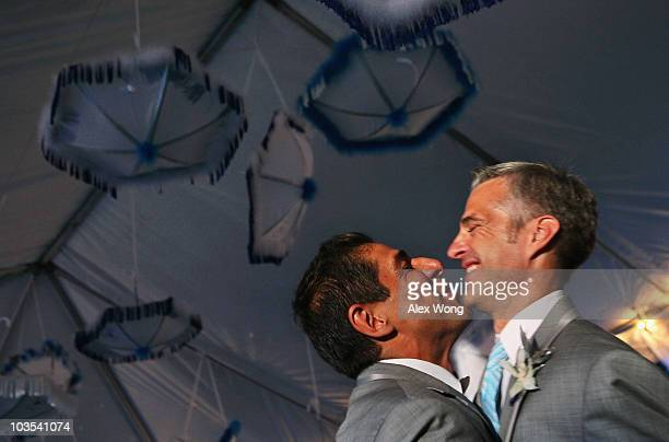 TV reporter Roby Chavez and his newly wedded husband Chris Roe dance during their wedding ceremony August 21 2010 at the Woodrow Wilson House in...