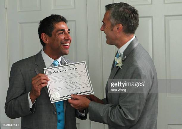 TV reporter Roby Chavez and his partner Chris Roe rejoice as they look at their marriage certificate prior to their wedding ceremony August 21 2010...