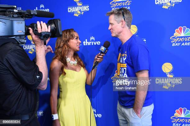 Reporter Rosalyn GoldOnwude interviews Steve Kerr of the Golden State Warriors during the Victory Parade and Rally on June 15 2017 in Oakland...