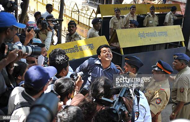A reporter rushes out from the special bomb proof court at the Arthur Road prison to break the news about Mohammad Ajmal Kasab's death sentence in...