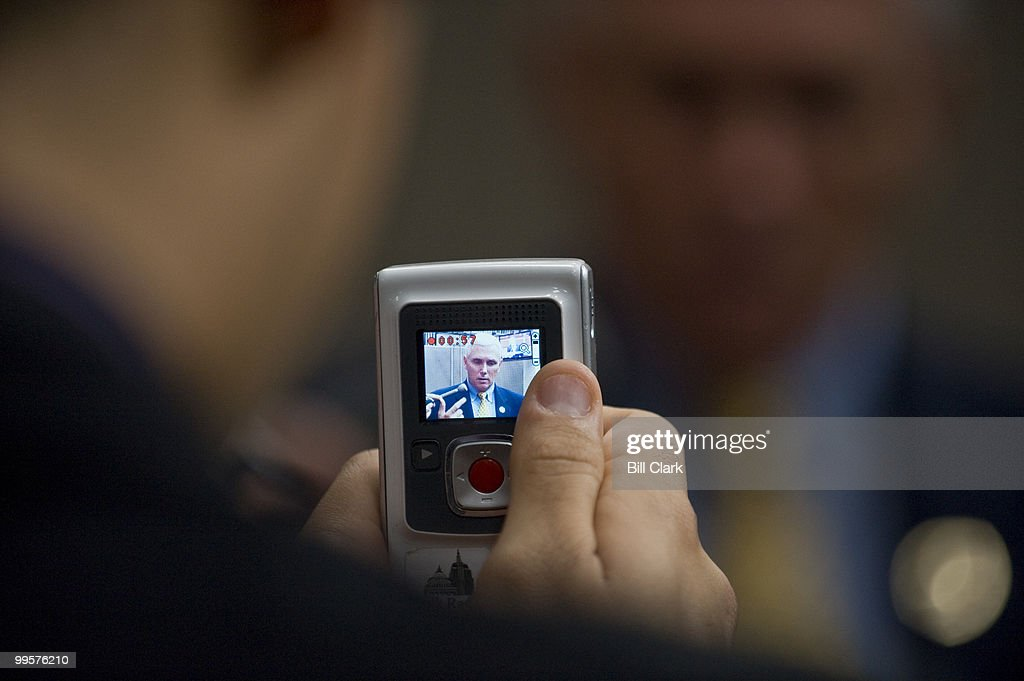 A reporter shoots digital video of Rep. Mike Pence, R-Ind., as he talks about health care following a news conference in the House Studio on Friday morning, Nov. 6, 2009.
