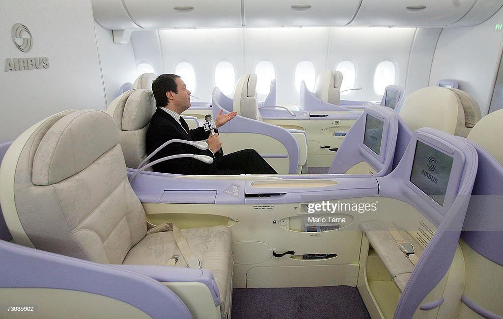 A reporter sits in a first-class seat of the new double-decker Lufthansa Airbus A380 after it arrived at JFK International Airport following its first route-proving flight to the United States with over 500 passengers March 19, 2007 in New York City. The A380 is the largest civil aircraft in history with a maximum take-off weight of 617 tons.