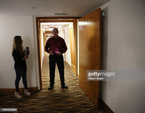 A reporter speaks to a man standing guard in the hallway of the Aventura condo at 18151 NE 31st Ct Apt where 56 yearold Cesar Sayoc was reported to...